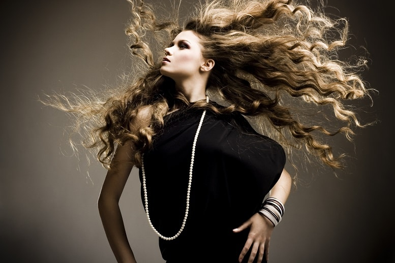 model with long curls posing glamour
